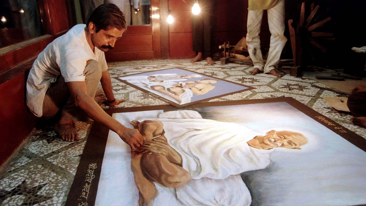 A man makes a portrait of Gandhi before the latter's death anniversary. (Photo: Reuters)