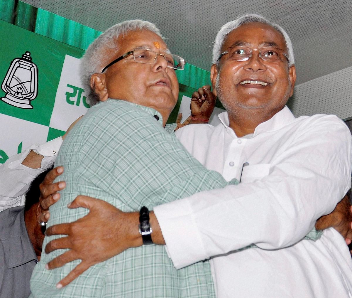 Bihar Chief Minister Nitish Kumar and RJD chief Lalu Prasad hug each other after Mahagathbandhan?s (Grand Alliance) victory in Bihar assembly elections at RJD office in Patna. (Photo: PTI)