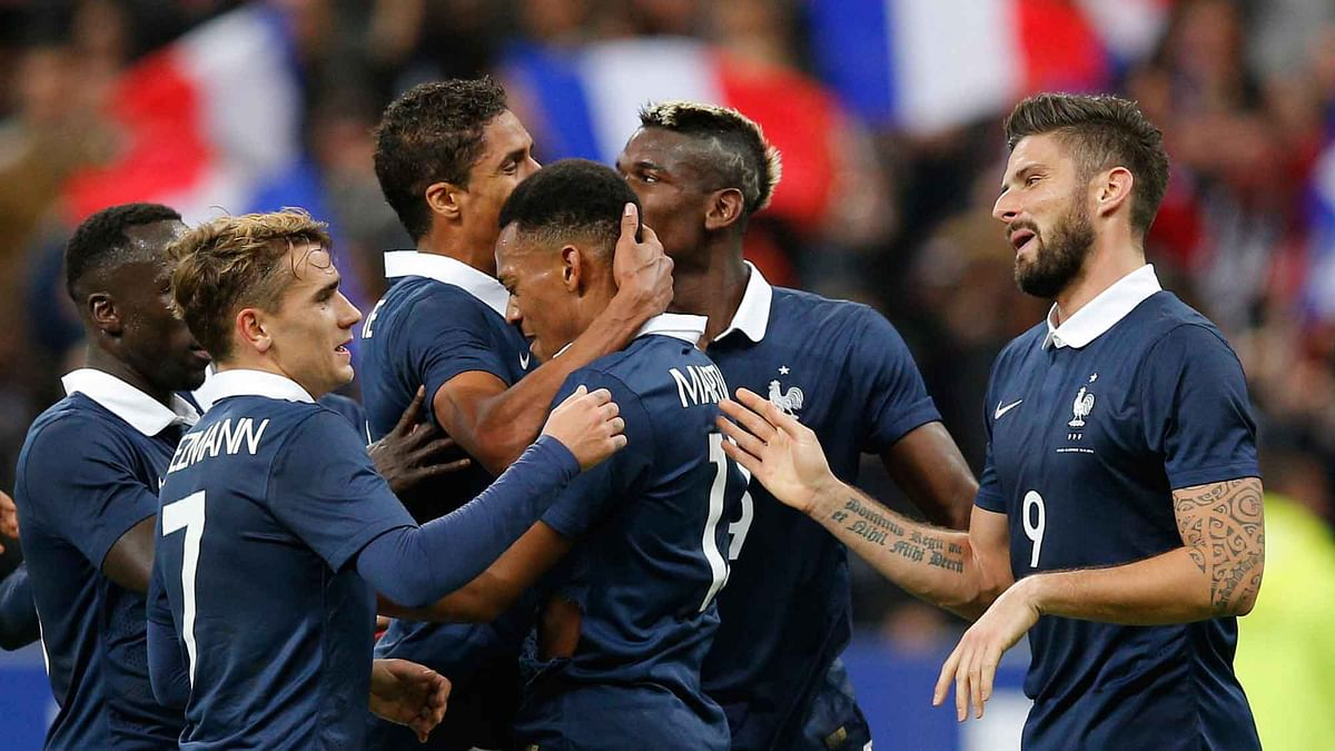 France's Olivier Giroud with his teammates after scoring the opening goal during the international friendly. (Photo: AP)