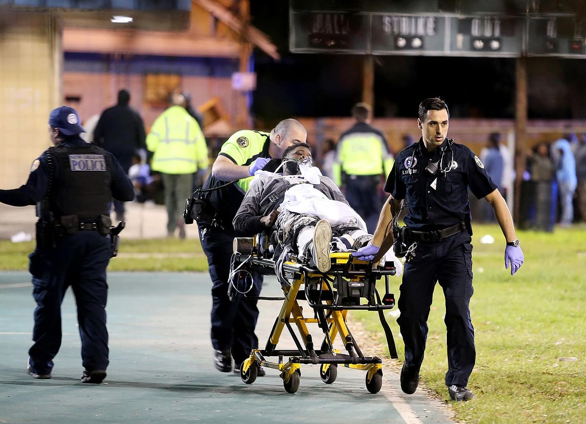 Paramedics carry an injured person out of the New Orleans shootout site. (Photo: AP)