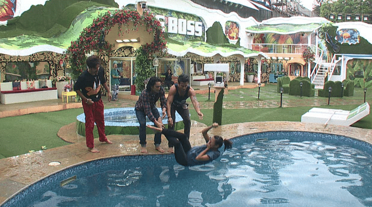 The boys throw Rochelle into the pool