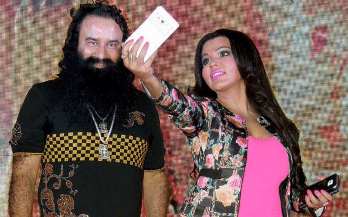 On top of their popularity game: Rakhi Sawant poses with MSG.