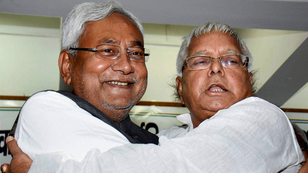 RJD chief Lalu Prasad hugging  Nitish Kumar after he was elected as leader of the Grand Alliance  in Patna, November 14, 2015.   (Photo: PTI)