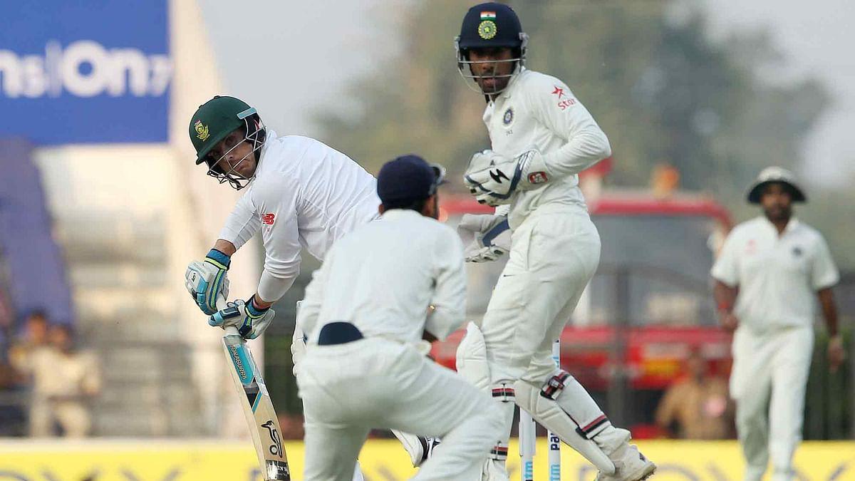 Stiaan van Zyl of South Africa looks back as Ajinkya Rahane takes the catch to dismiss him. (Photo: Ron Gaunt / BCCI / SPORTZPICS)