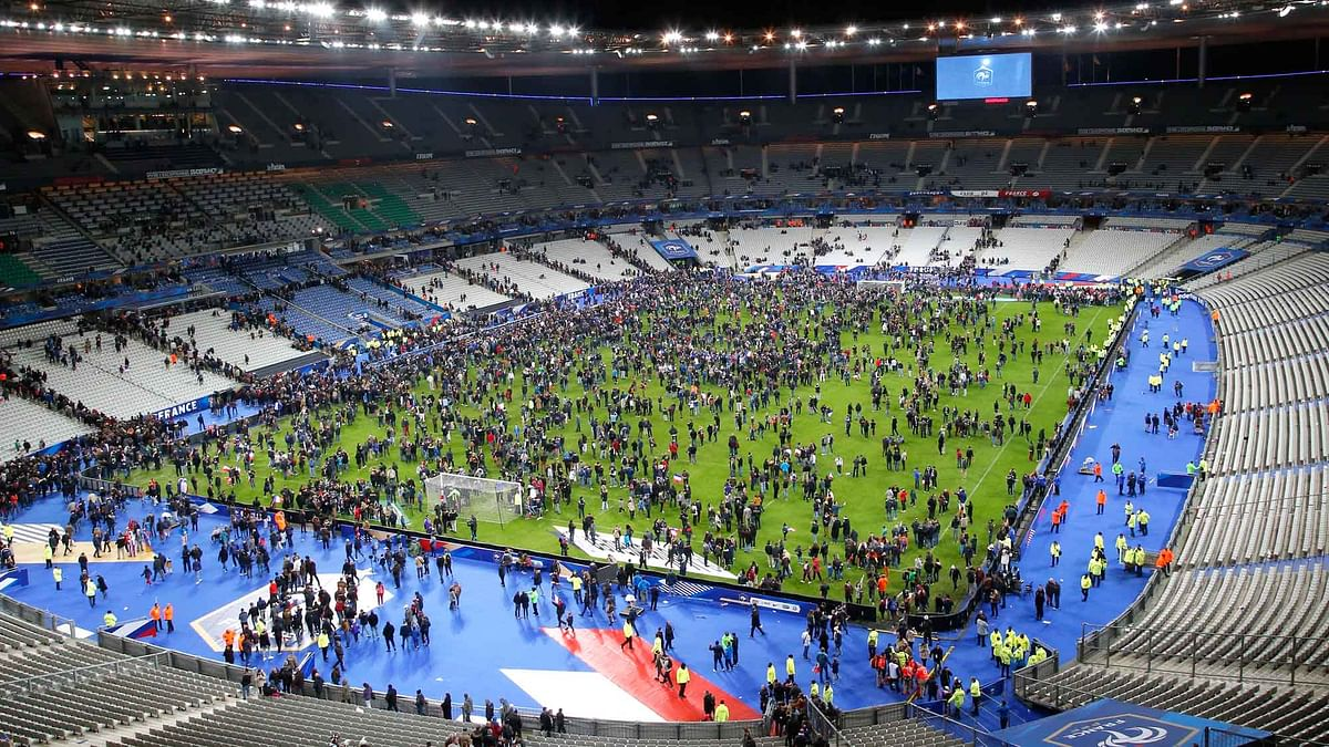 Spectators invade the pitch of the Stade de France stadium after the international friendly soccer France against Germany in Saint Denis. (Photo: AP)