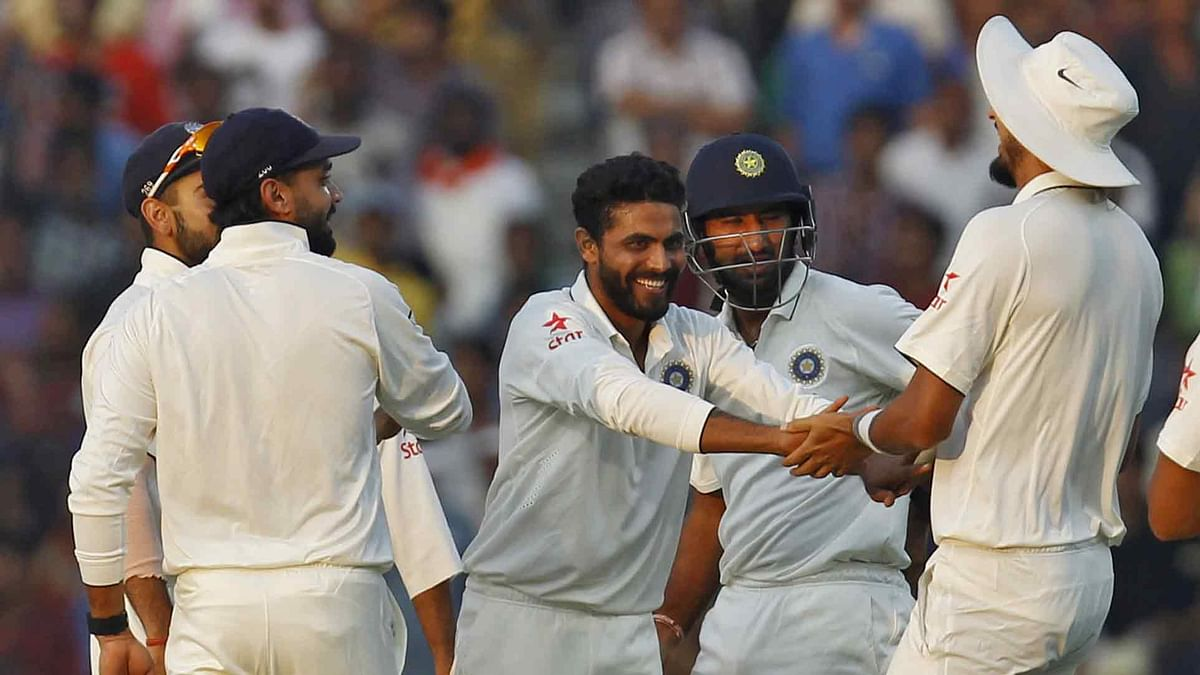 Ravindra Jadeja and the Indian team celebrate a South African wicket near the end of Day 1 of the Nagpur Test. (Photo: Reuters)