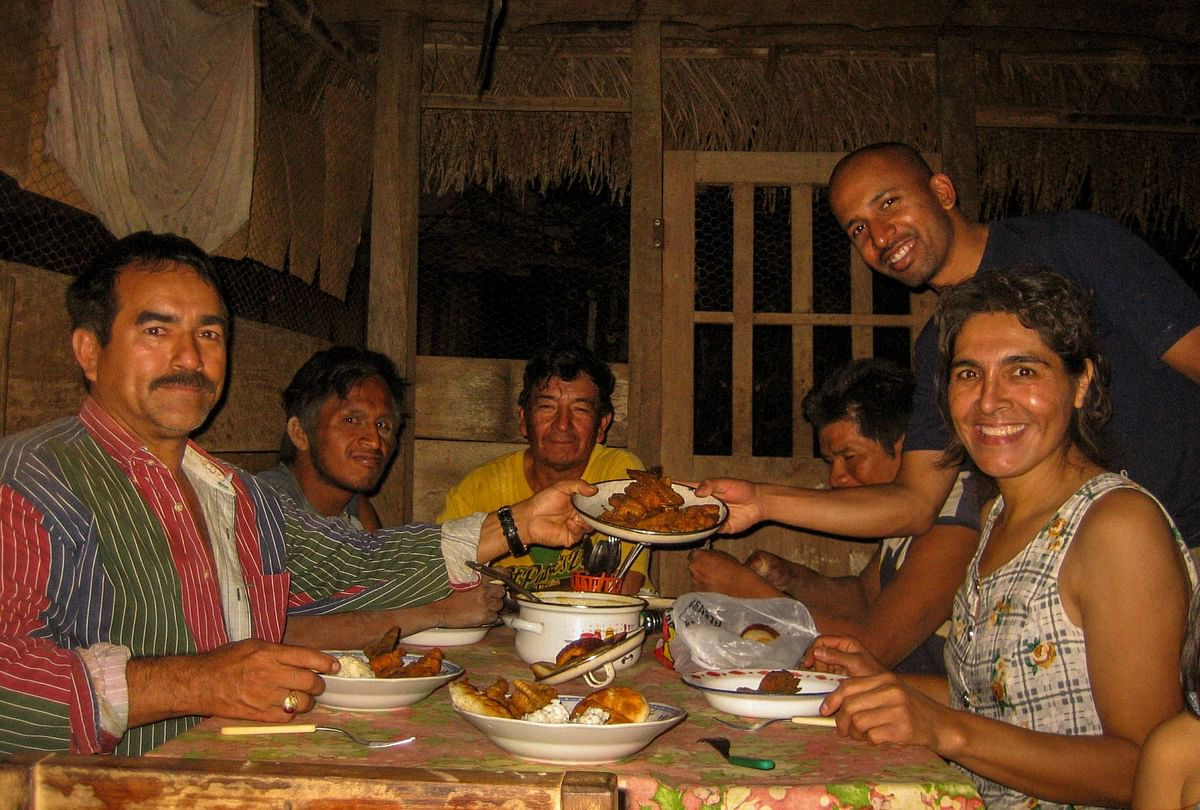 Being invited for dinner by local farmers in northern Bolivia. (Photo Courtesy: Jay Kannaiyan)