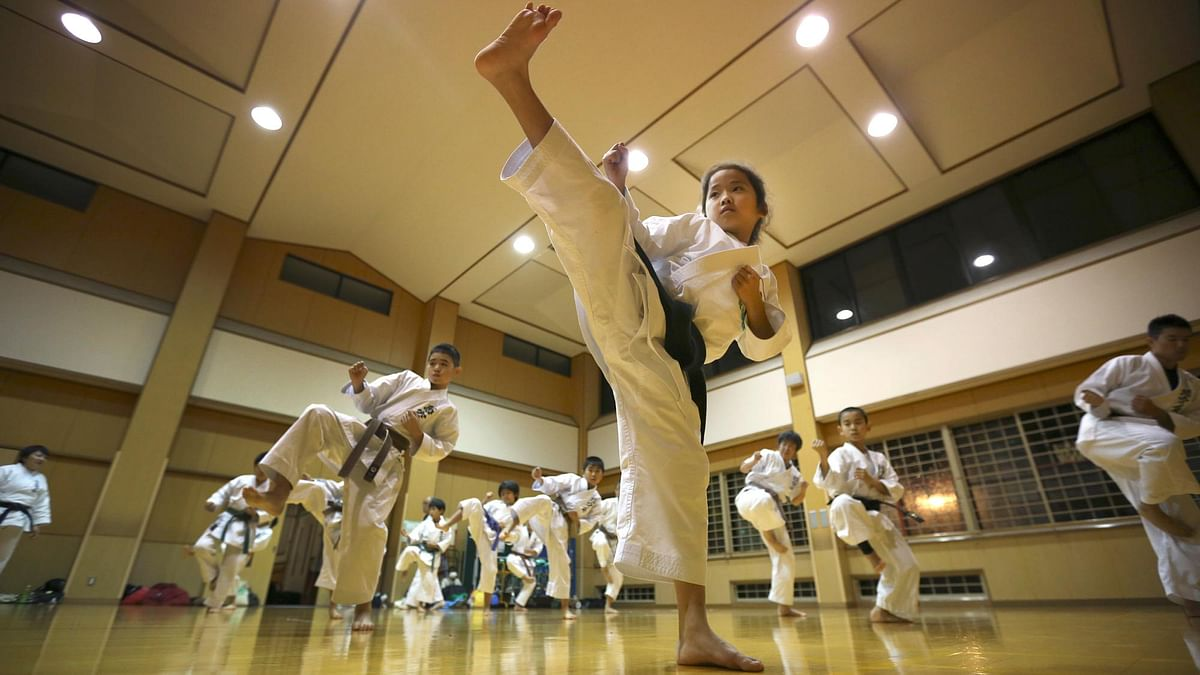 In this Nov. 18, 2015 photo, 9-year-old Mahiro Takano, center, three-time Japan karate champion in her age group practices in Nagaoka, Niigata Prefecture, north of Tokyo.(Photo: AP)