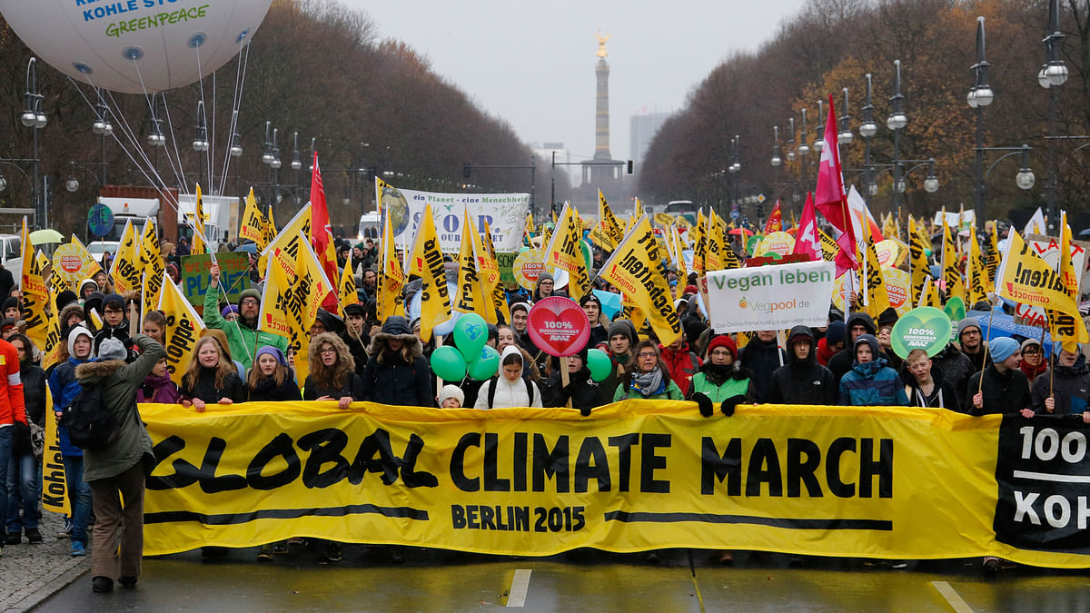 People demonstrate during a protest march ahead of the 2015 Paris Climate Conference, known as the COP21 summit, along Strasse des 17 June in Berlin. (Photo: Reuters)
