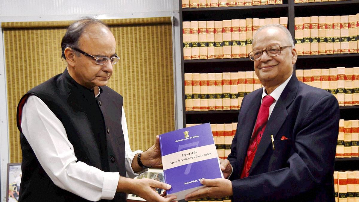 Finance Minister Arun Jaitley receiving the Seventh Pay Commission report from the Commission's chairman, Justice A K Mathur in New Delhi. (Photo: PTI)