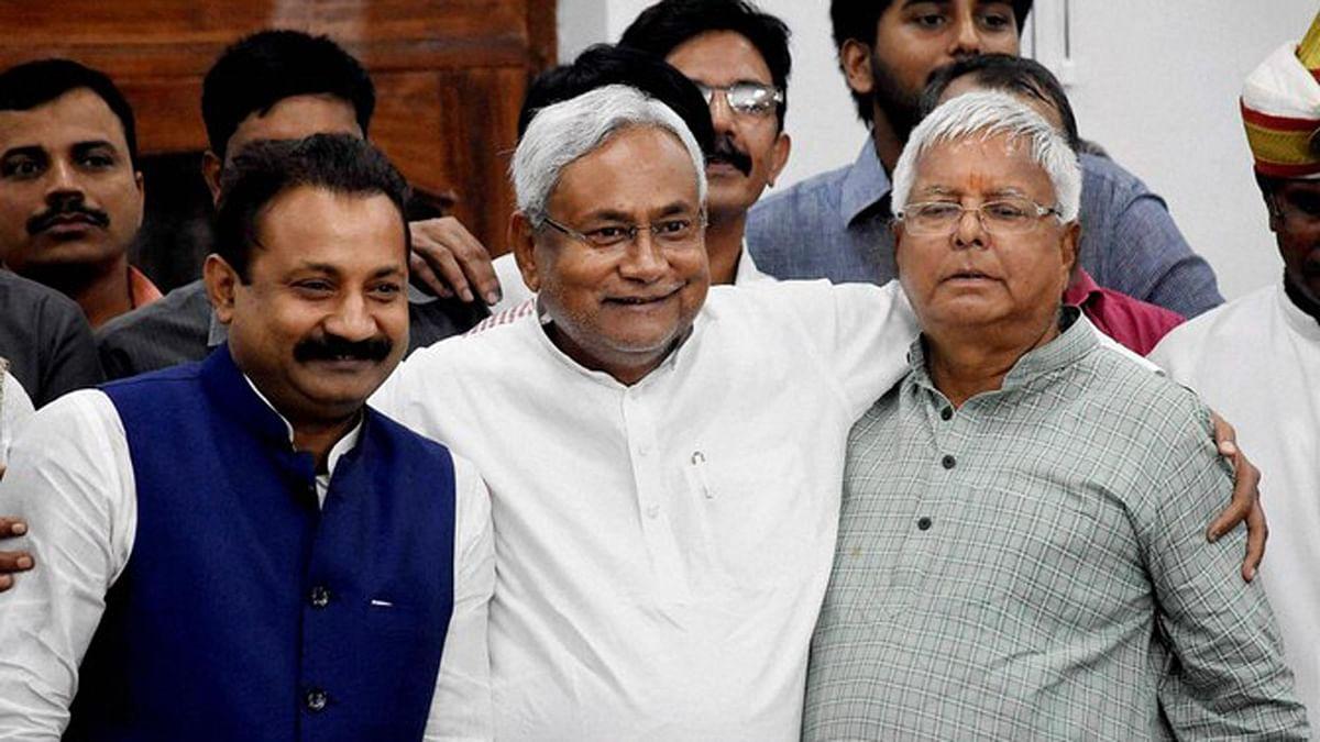 Bihar Chief Minister Nitish Kumar, RJD Chief Lalu Prasad and Bihar Congress President Ashok Chaudhary at a press conference after the Mahagathbandhan's victory. (Photo: PTI)
