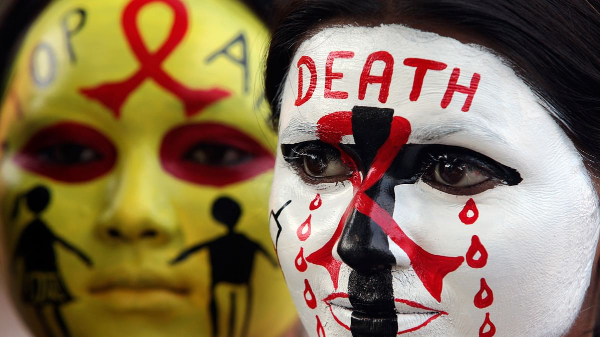 Volunteers pose with HIV/AIDS awareness messages on their faces during an event  ahead of the World AIDS Day in  Chandigarh. Image used for representation only.