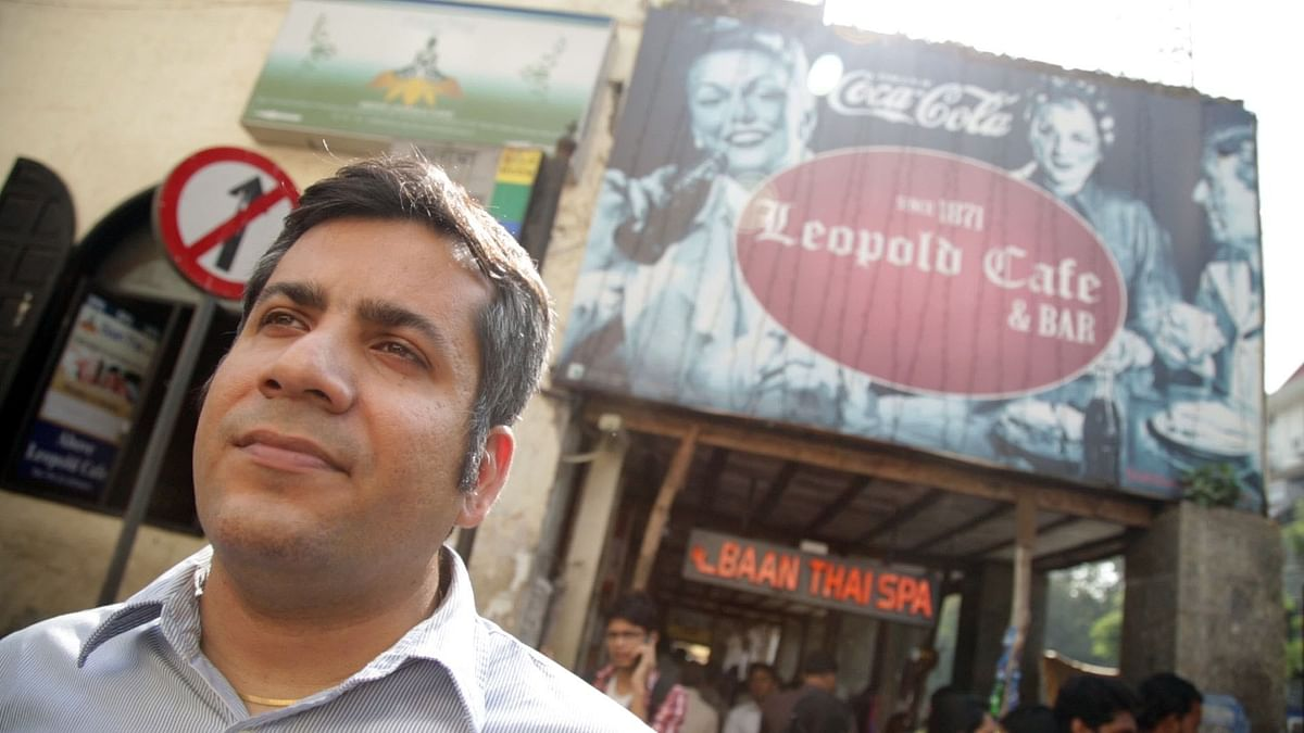 Sourav Mishra stands outside Leopold Cafe, where he was having dinner with friends on the night of November 26, 2008 (Photo: The Quint)