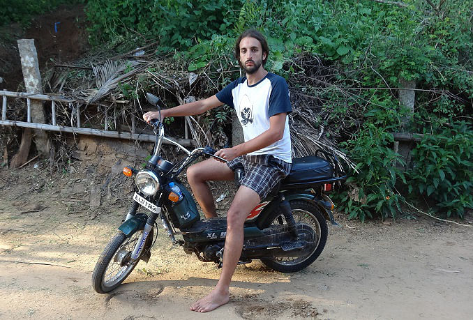 San feeling possessive about his little moped after I rode it around. (Photo Courtesy: Sonal Kwatra Paladini/Drifter Planet)