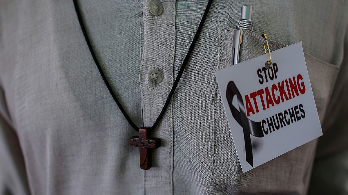 A protester attends a rally by hundreds of Christians against recent attacks on churches nationwide, in Mumbai February 9, 2015 (Photo: Reuters)