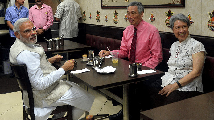 Prime Minister Narendra Modi and his Singaporean counterpart PM Lee Hsien Loong go for tea to an Indian restaurant in Little India, Singapore.