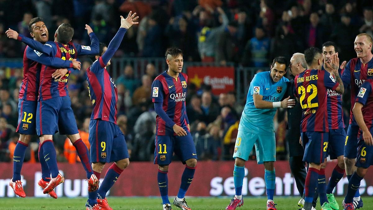 Barcelona's players celebrate their victory 2-1 against Real Madrid at the end of their clash against Madrid in March this year. (Photo: Reuters)