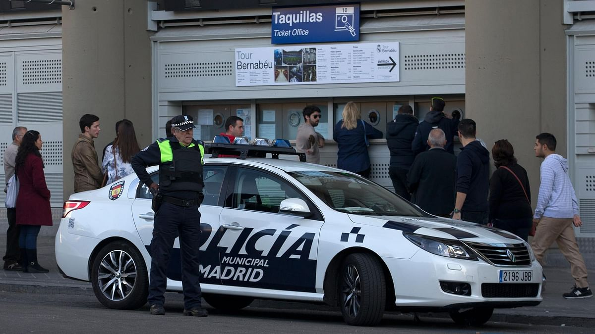 A police officer stands by a patrol car outside the Santiago Bernabeu stadium in Madrid. (Photo: AP)<a></a>