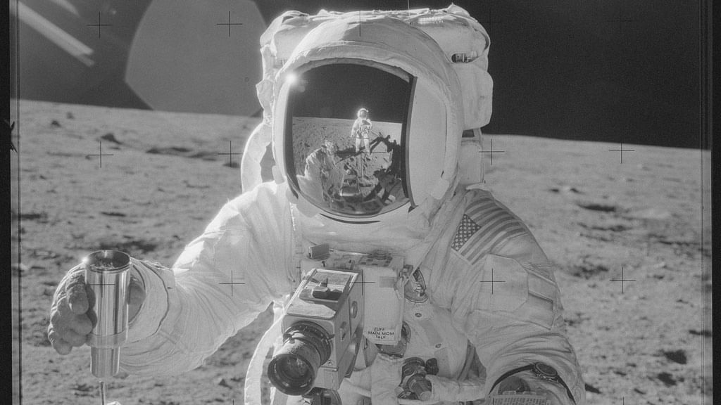 Astronaut Alan L Bean holds a Special Environmental Sample Container filled with lunar soil collected during the Apollo 12 mission in this November 19, 1969 NASA handout photo. Mission commander Charles Conrad Jr., who took this picture, is reflected in Bean's helmet visor. (Photo: Reuters)