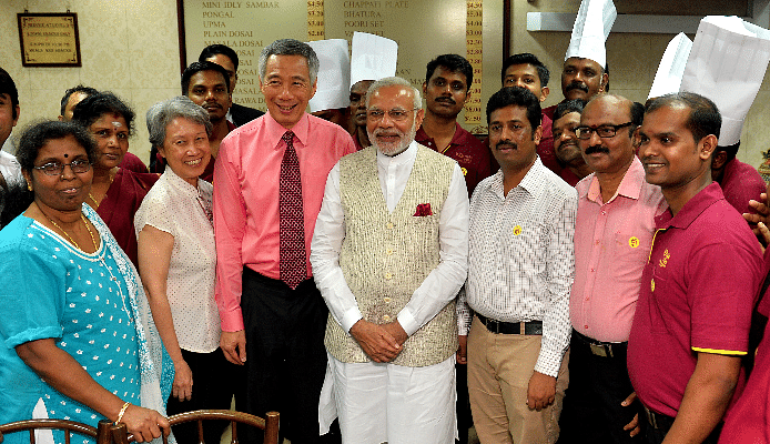 PM Modi with Singapore PM Lee Hsien Loong in an Indian restaurant in Singapore.