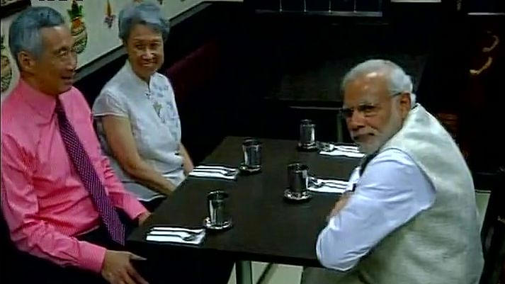 Singapore's Prime Minister Lee Hsien Loong and his wife with Prime Minister Modi at Komala Vilas restaurant in 'Little India'. (Photo: ANI)
