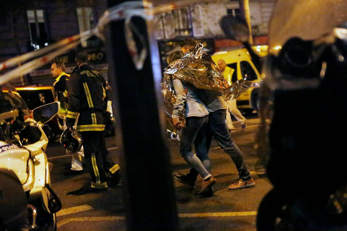 A person  being evacuated after a shooting outside the Bataclan theatre in Paris. (Photo: AP)