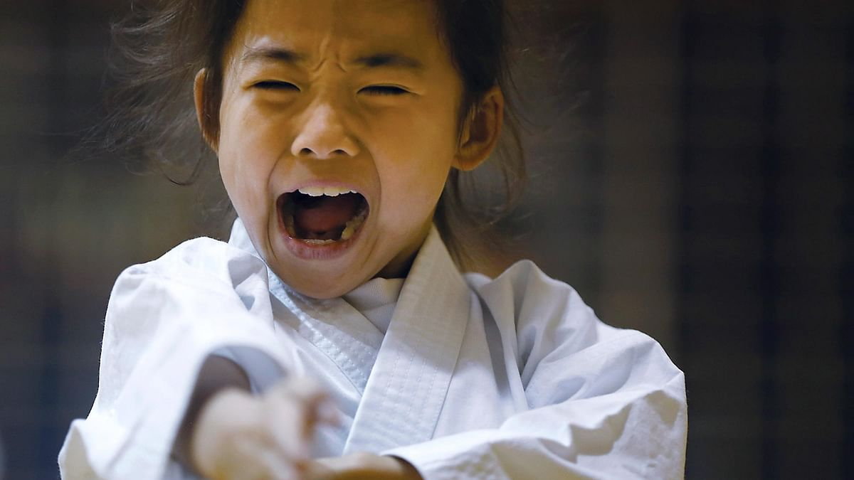 In this Nov. 18, 2015 photo, 9-year-old Mahiro Takano, three-time Japan karate champion in her age group, practices in Nagaoka, Niigata Prefecture, north of Tokyo. (Photo: AP)