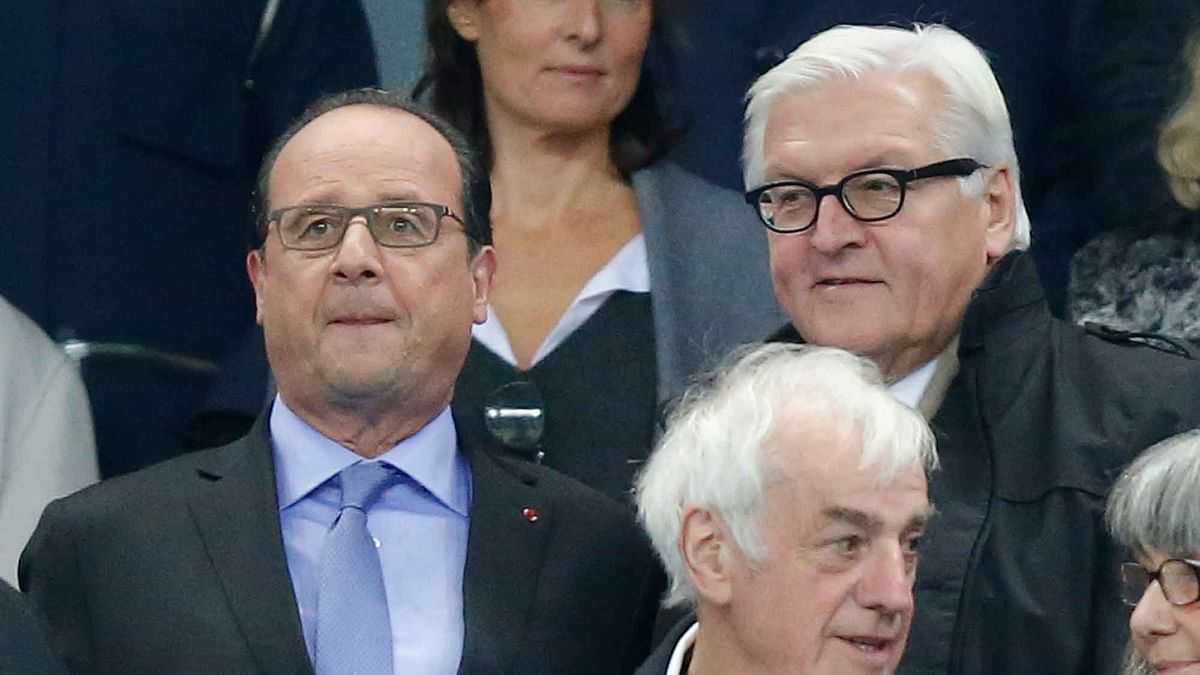 French President Francois Hollande, left, and German Foreign Minister Frank-Walter Steinmeier at the match. (Photo: AP)<a></a>