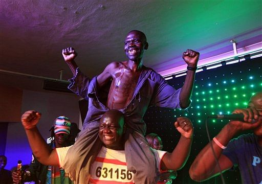 Mison Sere reacts, top, after winning the 2015 edition of the Mr Ugly competition, in Harare. (Photo: AP)