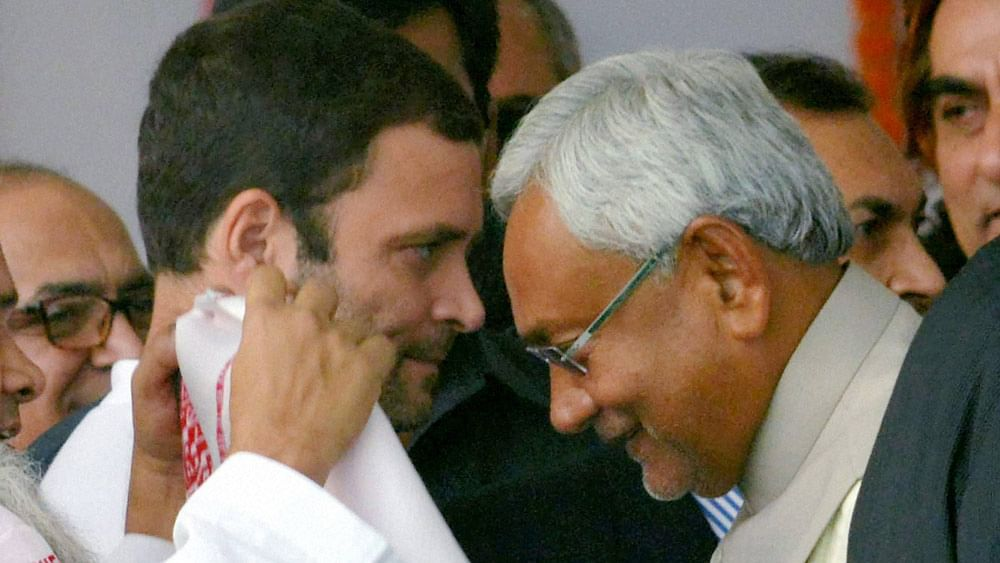 Congress Vice President Rahul Gandhi greets Chief Minister Nitish Kumar during the latter's swearing-in ceremony at Gandhi Maidan in Patna, November 20, 2015. (Photo: PTI)