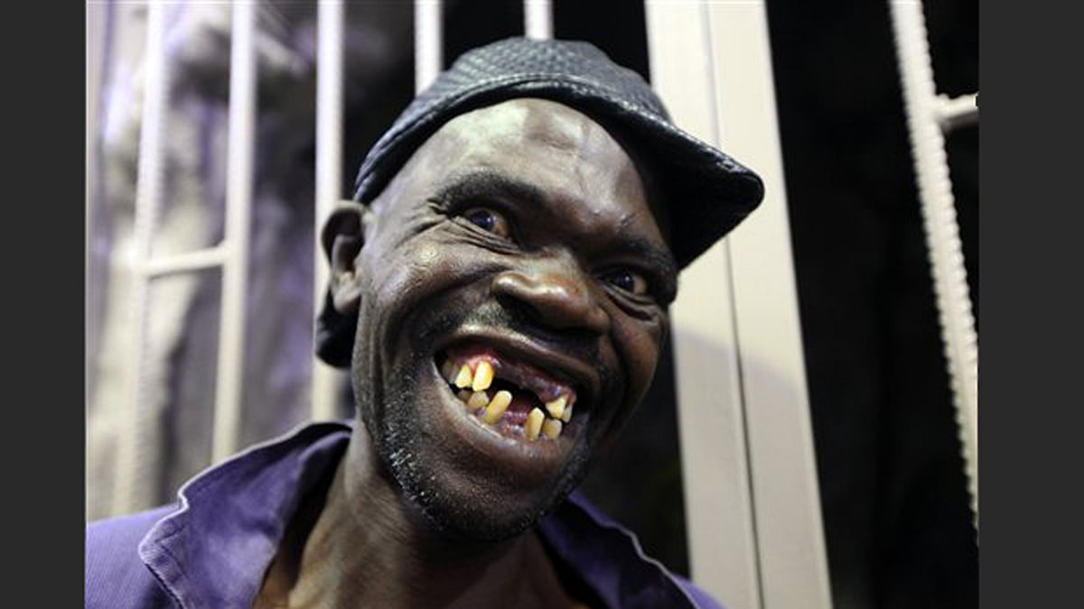 Mison Sere smiles after winning the 2015 edition of the Mr Ugly competition, in Harare. (Photo: AP)