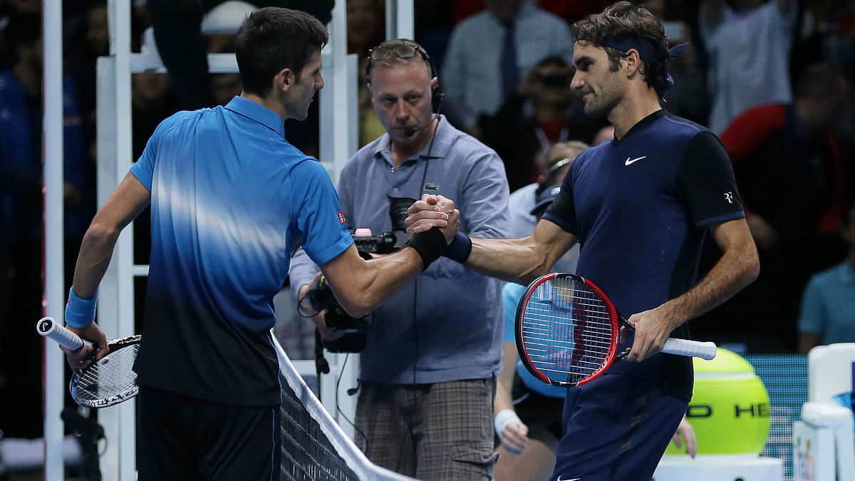 Switzerland's Roger Federer shakes hands with Serbia's Novak Djokovic after winning the ATP World Tour Finals tennis match at the O2 Arena in London. (Photo: AP)