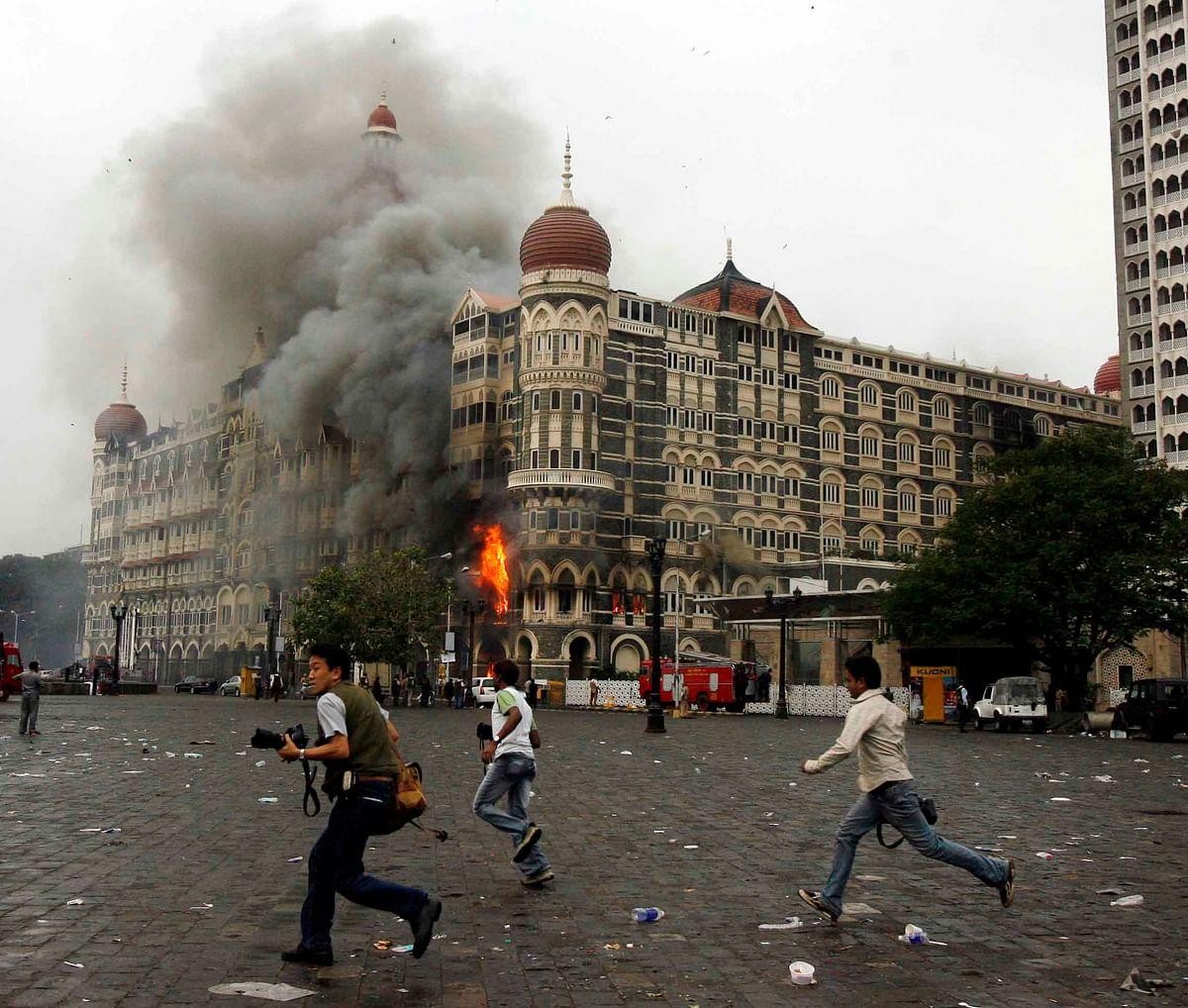 Photographers outside Taj Mahal Hotel during terror attacks in 2008 (Photo: Reuters)