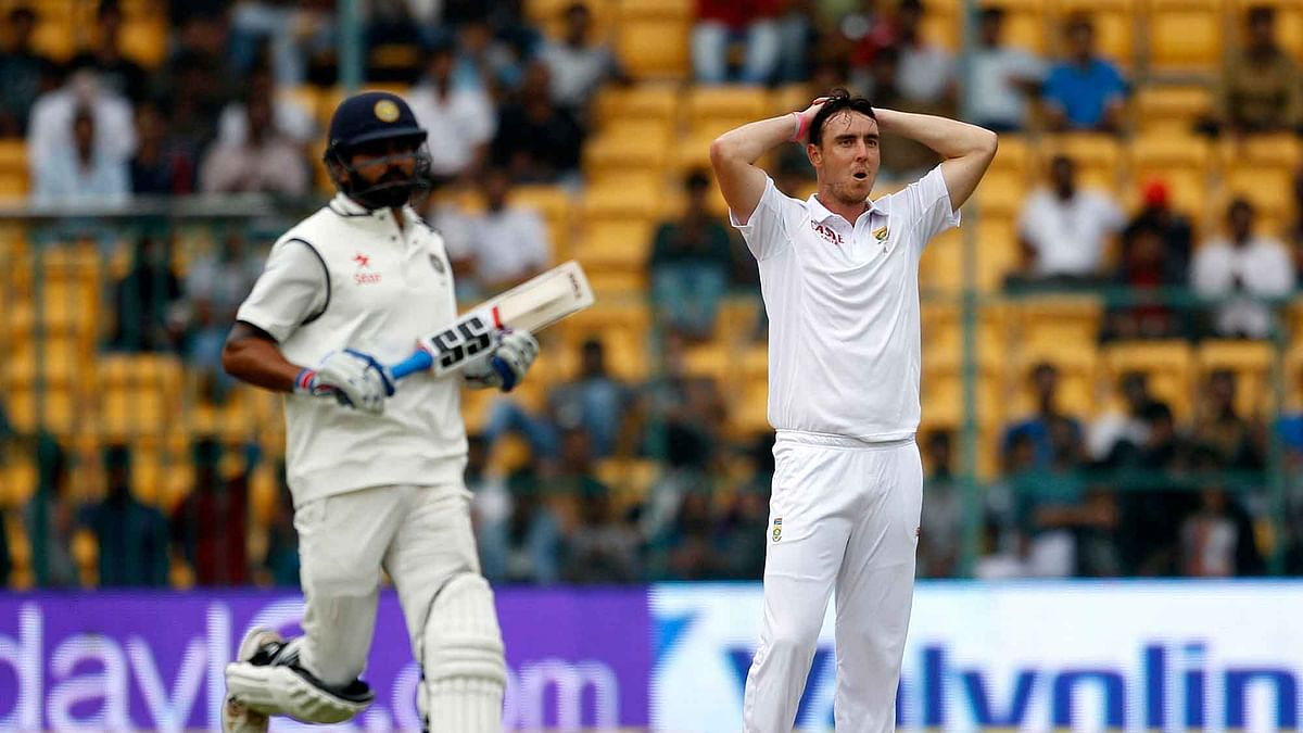 South Africa's Kyle Abbott, right, reacts after India's Shikhar Dhawan hit a boundary. (Photo: AP)<a></a>