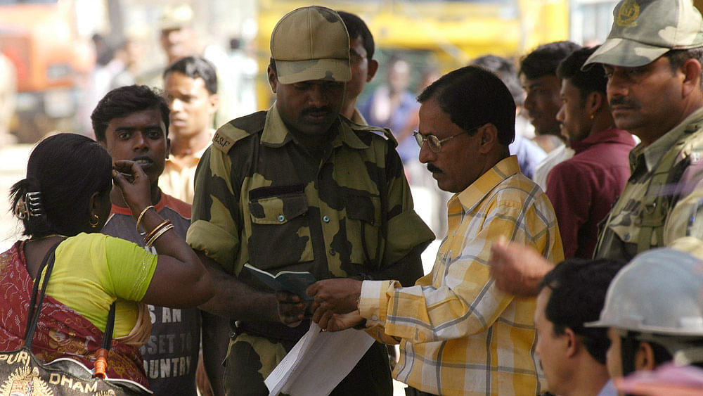 Indian Border Security Force (BSF) personnel and an immigration officer check the passport of a Bangladeshi citizen at Akhaura check-post of the India-Bangladesh border on the outskirts of Agartala. (File Photo: Reuters)