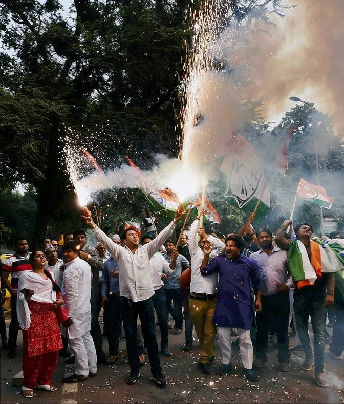 Congress supporters burn crackers as they celebrate Bihar poll results, at party headquarters in New Delhi on Sunday. (Photo: PTI)