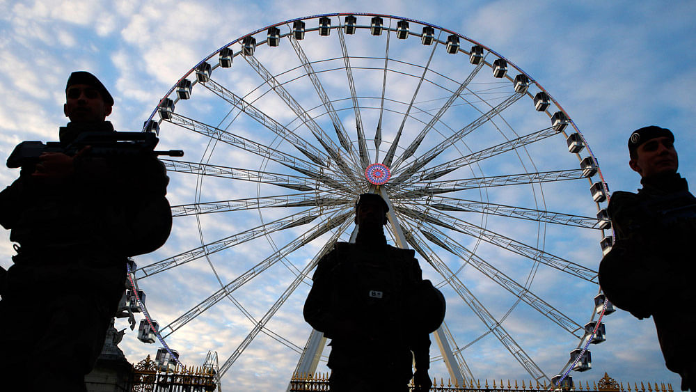 French soldiers patrol in front of the Paris Big Wheel next to the Champs Elysees, in Paris on November 22, 2015, one week after the Paris attacks. (Photo: AP)