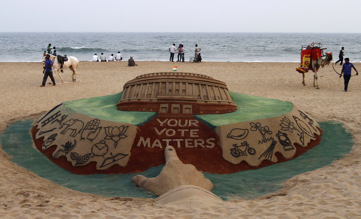 A sand sculpture by artist Sudarshan Patnaik depicts the Indian Parliament with various parties' election symbols. (Photo: Reuters)