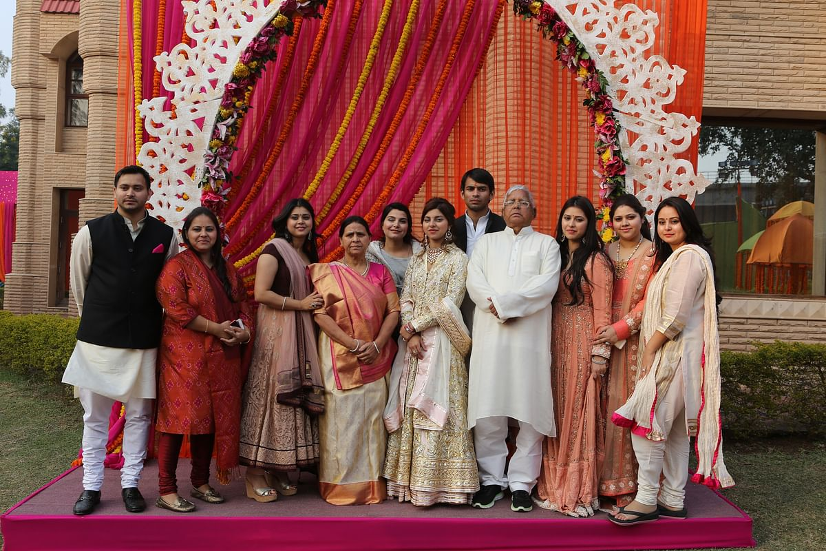 Lalu Prasad Yadav and Rabri Devi with their seven daughters and two sons at the youngest daughter Raj Laxmi's engagement ceremony in February 2015. (Photo: <b>The Quint</b>)