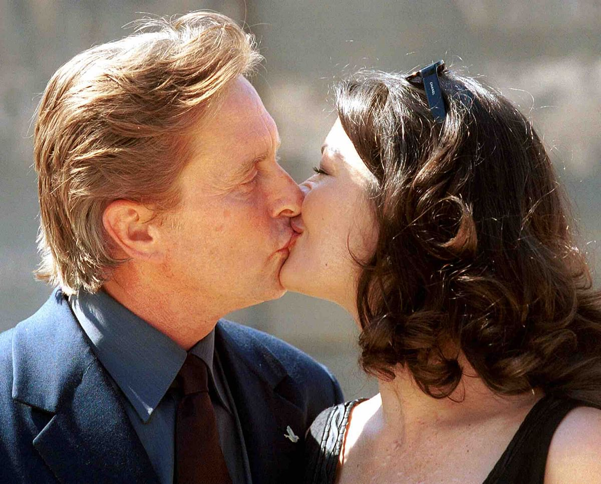 Michael Douglas and new wife, actress Catherine Zeta-Jones, shown kissing on the Spanish Island of Mallorca on March 25, 2000 (Photo: Reuters)