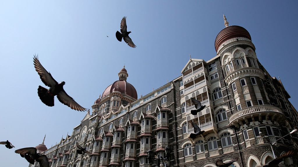 Pigeons fly outside the Taj Mahal Hotel, which was one of the targets of the 26/11 attacks in Mumbai in November  2008. (Photo: Reuters)
