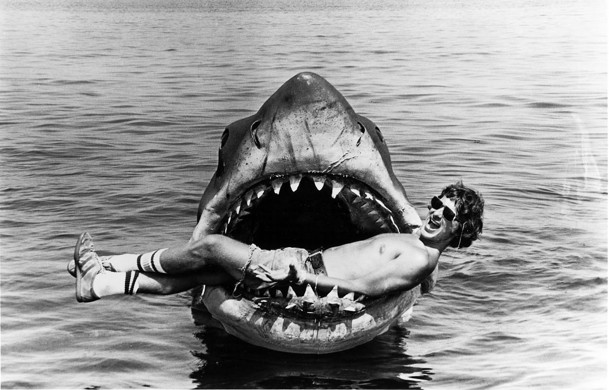 Spielberg poses with his mechanised shark on the sets of <i>Jaws.</i>