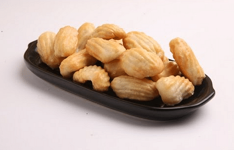"""These golden brown kulkuls will be lapped up by your family members in no time. (Photo Courtesy: <a href=""""https://www.youtube.com/watch?v=xGF6k2y3gUI"""">YouTube screenshot</a>)"""