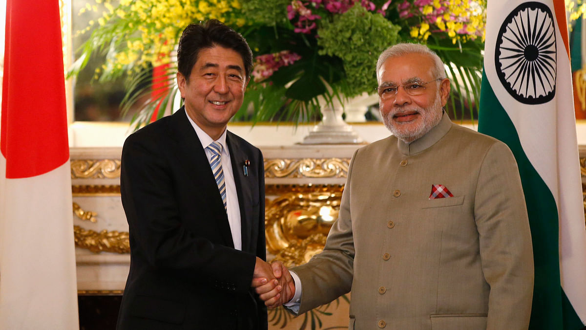 Prime Minister of Japan Shinzo Abe and Prime Minister Modi shake hands at the Tokyo Summit in 2014. (Photo: Reuters)