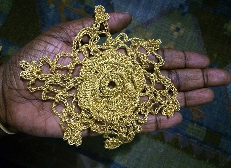 Artist Mithu Sen holding the gold crochet gifted to her by Hema (Photo courtesy: Mithu Sen)