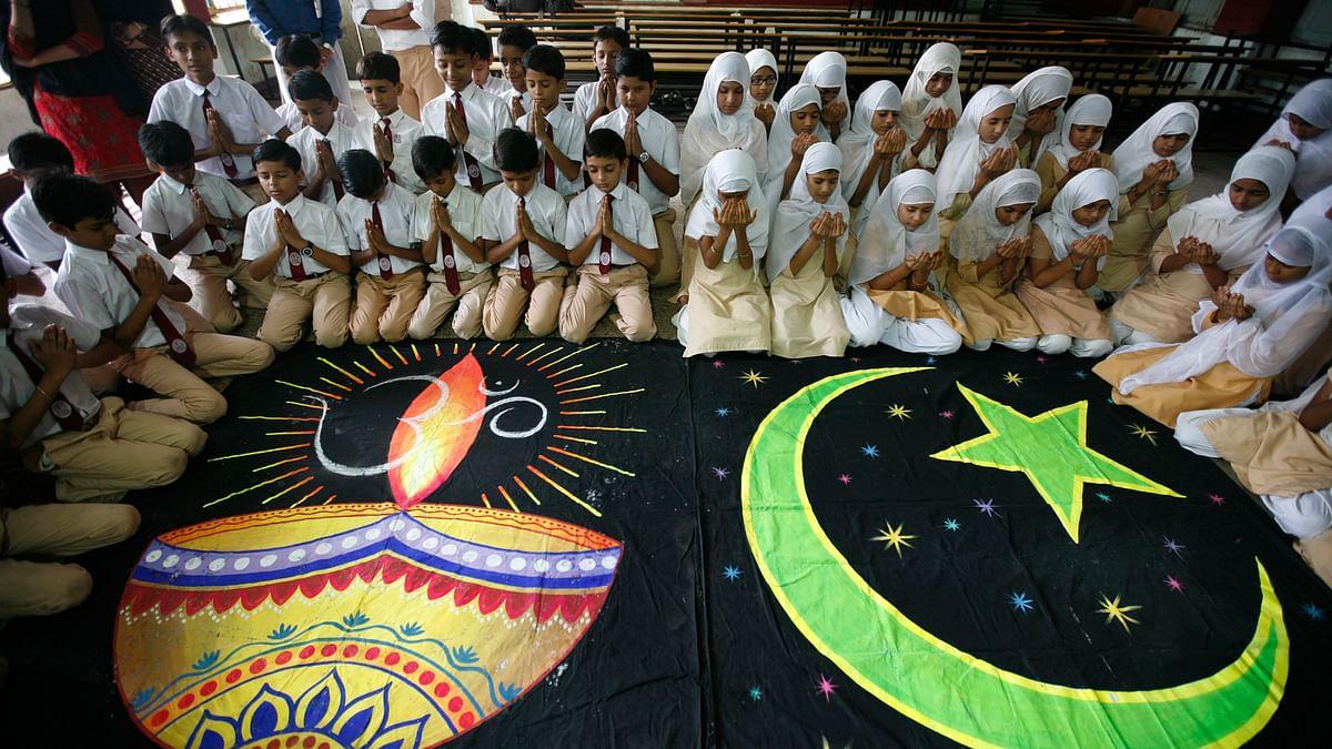 Hindu and Muslim school children offer prayers for peace inside their school in Ahmedabad.
