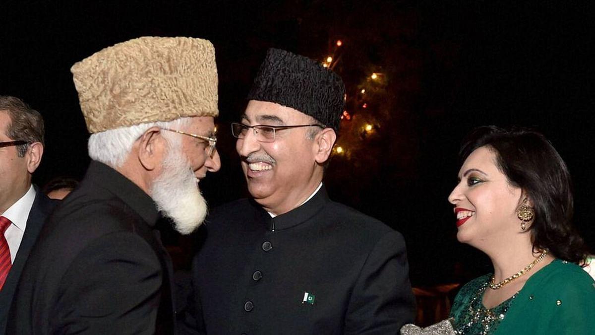 Hurriyat leader Syed Ali Shah Geelani greeting Pakistan High Commissioner to India Abdul Basit. (Photo: PTI)