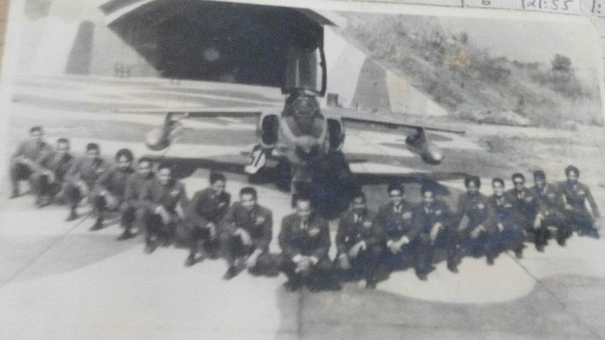Officers of the 18 Squadron taken at Srinagar airfield in 1971. In the background is a Gnat and the bomb-proof pen where both the pilots and planes could have been safe.