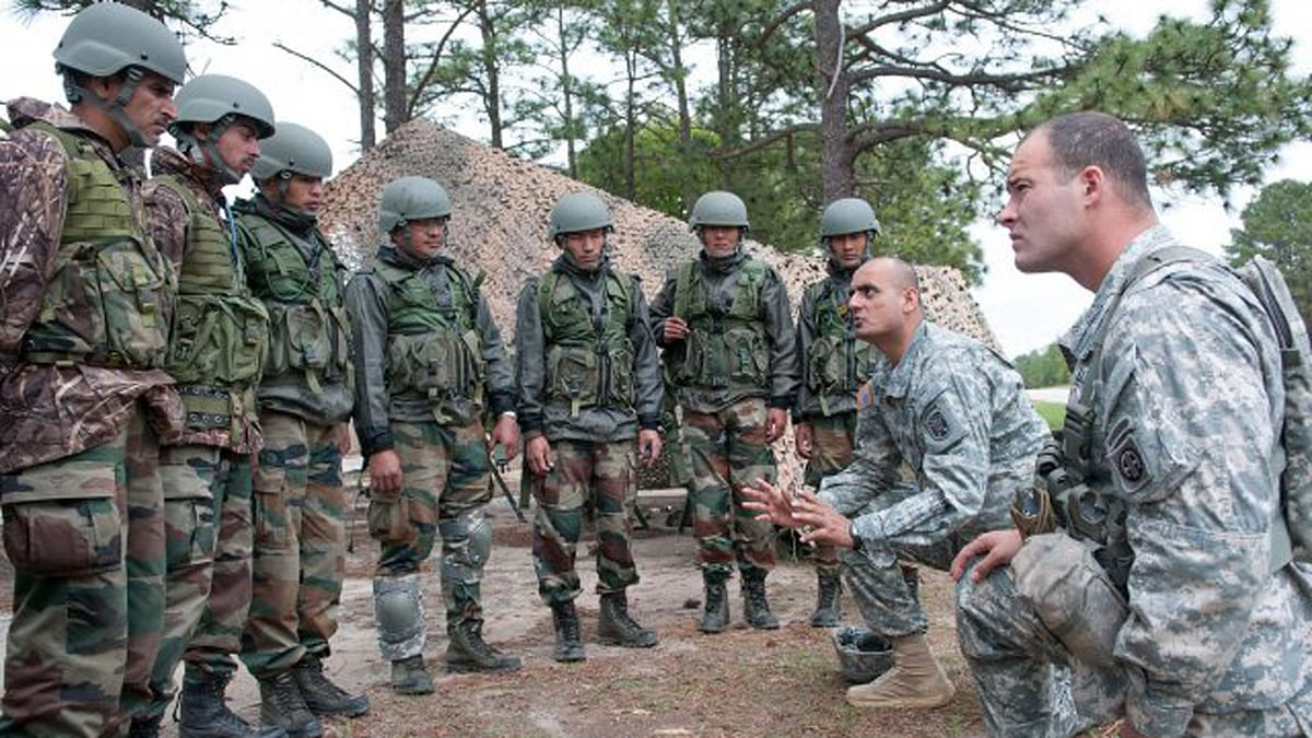 """US Army paratrooper explains weapon range safety procedures to Indian Army troops. (Photo Courtesy: US army <a href=""""http://www.army.mil/article/103127/Yudh_Abhyas_2013_Begins/"""">official website</a>)"""
