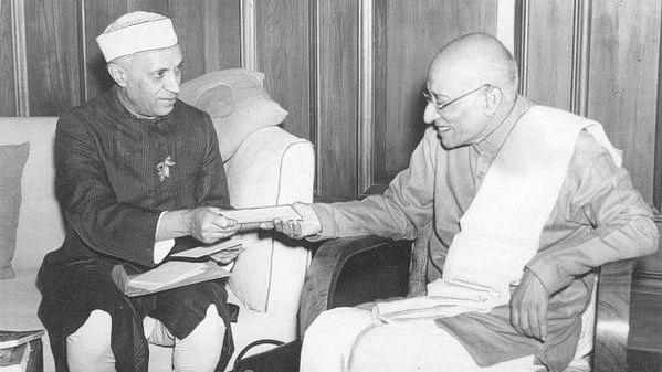 C Rajagopalachari, in a meeting with Jawaharlal Nehru.